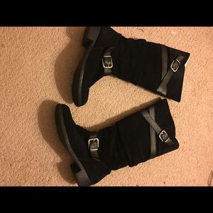 Black pair of suede boots with wrap around belts
